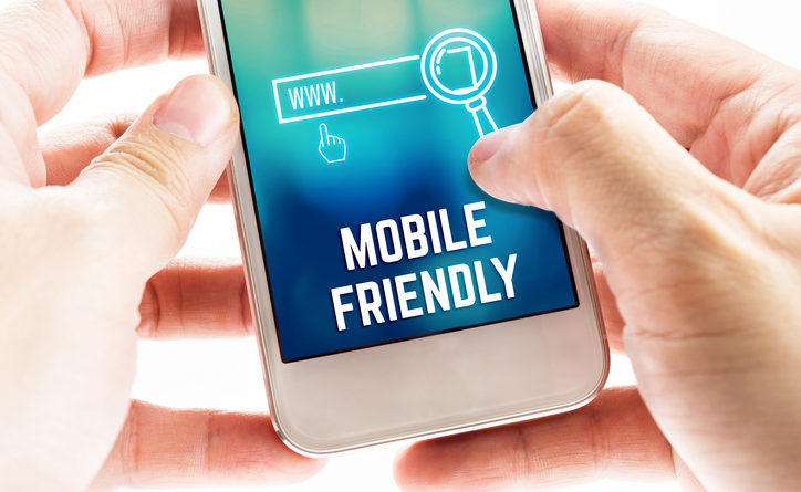 Close up Two hand holding mobile phone with mobile friendly and search icon, Digital Marketing concept.